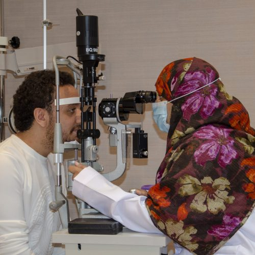 Dr. Manal doing checkup of the patient